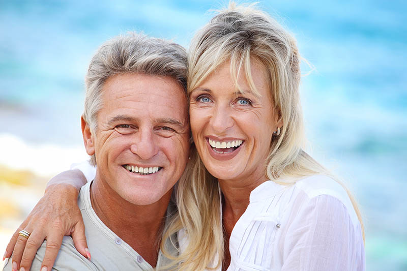 senior couple with dentures from the prosthodontist