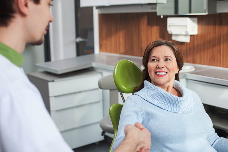 woman discussing deep cleaning with the dentist
